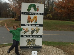 Malachi near the museum sign