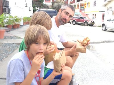 Matt (whose head is beginning to recover from the St. John haircut) and the boys having a snack while doing errands