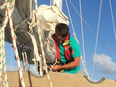 The captain pulling in the mainsail