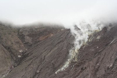 The steam and sulfur gas rising up from the volcano