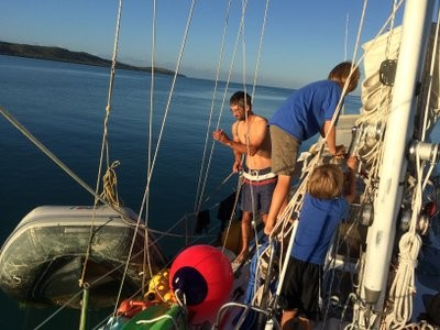 Before we left, Matt and the boys hoist the dinghy up to stow it on deck for the long passages.