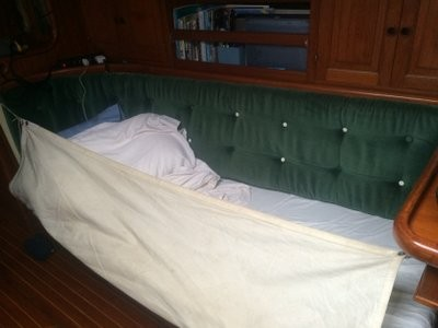 Settee in the cabin turns into a berth with the lee cloth up