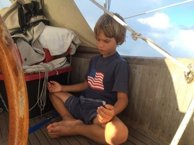 Matt has Joshua meditate to keep his eyes closed and avoid seasickness