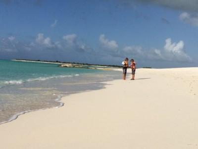 Huck Finn and Tom Sawyer find conch shells on the beach